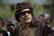 <p>Libyan leader Muammar Gaddafi meets local school children during a break in the African Union Summit meeting in Uganda's capital Kampala July 26, 2010. REUTERS/Benedicte Desrus</p>