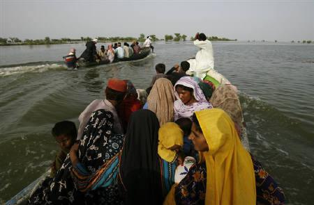 Villagers from flooded villages sit in a boat as they are rescued by volunteers in Patuja Lane near Shahdadkot, some 145 kilometres (90 miles) from Sukkur, in Pakistan's Sindh province in this August 27, 2010 file photo. REUTERS/Athar Hussain