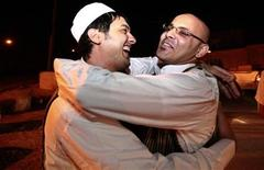 <p>A member (L) of the Libyan Islamic Fighting Group hugs his relative upon his release from Abu Salim prison near Tripoli, August 31, 2010. REUTERS/Ismail Zitouny</p>