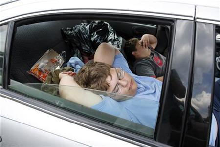 People sleep in their car as they wait to enter the Remote Area Medical (RAM) health clinic at the Wise County Fairgrounds in Wise, Virginia July 25, 2009. REUTERS/Shannon Stapleton
