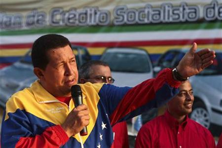 Venezuelan President Hugo Chavez attends an event to promote loans to buy cars made in Iran in Maracay Venezuela August 31, 2010. REUTERS/Miraflores Palace/Handout