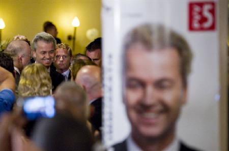 Dutch right-wing politician Geert Wilders of the Freedom Party arrives to speech after the announcement of the results for the general elections, in The Hague June 9, 2010. REUTERS/Robin van Lonkhuijsen/United Photos/Files