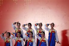 <p>Performers from North Korea dance during a ceremony celebrating North Korea Pavilion Day at the Shanghai World Expo site September 6, 2010. REUTERS/Aly Song</p>