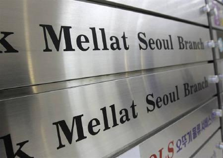 Signs of Iran's Bank Mellat are seen on a direction board in the lobby of the bank's Seoul branch office September 8, 2010. REUTERS/Jo Yong-Hak