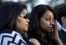 <p>A woman wipes her face at a 25th anniversary memorial gathering at the Air India monument in Toronto June 23, 2010. REUTERS/Mark Blinch</p>