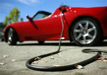 A Tesla Roadster is electrically charged at Tesla Motors Inc in San Carlos, California July 22, 2009. REUTERS/Robert Galbraith