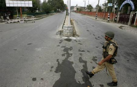 A policeman walks on a deserted road during a curfew in Srinagar September 13, 2010. REUTERS/Danish Ismail