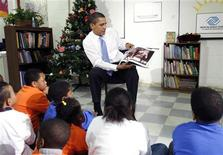 "<p>President Barack Obama reads the Christmas book ""The Polar Express"" to children during a visit to a Boys and Girls Club in Northeast Washington December 21, 2009. REUTERS/Kevin Lamarque</p>"