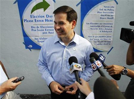 Republican Senate candidate Marco Rubio speaks to reporters after casting his ballot in Florida's primary election in Miami August 24, 2010. REUTERS/Joe Skkipper