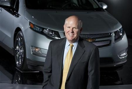 Dan Akerson stands with the 2011 Chevrolet Volt electric vehicle with extended range at General Motors headquarters in Detroit, Michigan, August 31, 2010. REUTERS/John F. Martin/General Motors/Handout