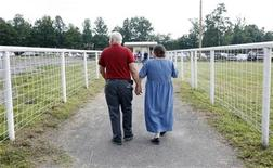 <p>A couple leaves the Remote Area Medical (RAM) health clinic at the Wise County Fairgrounds in Wise, Virginia July 24, 2009. REUTERS/Shannon Stapleton</p>