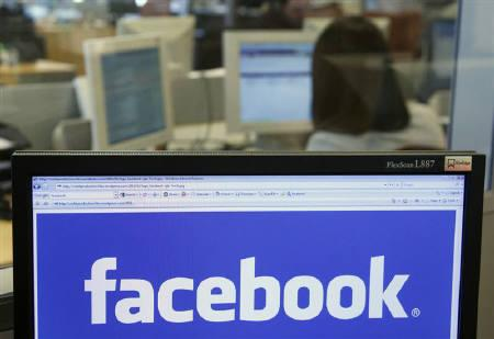 The Facebook logo is displayed on a computer screen in Brussels April 21, 2010. Rotten Tomatoes, the film website known for aggregating movie reviews, is partnering with Facebook to give its readers the opportunity to recommend films to their other Facebook friends. REUTERS/Thierry Roge/Files