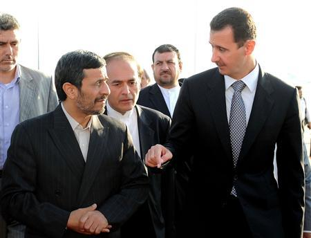 Syria's President Bashar al-Assad (R) welcomes Iran's President Mahmoud Ahmadinejad,in Damascus September 18, 2010. REUTERS/Sana