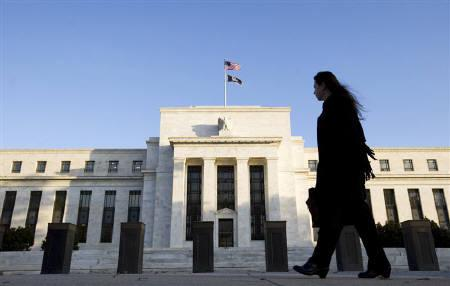 A woman walks in front of the Federal Reserve Building in Washington in this October 29, 2008 file photo. REUTERS/Larry Downing/Files
