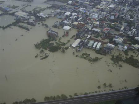 A handout photograph taken on September 20, 2010 shows an aerial view of the flooding caused by Typhoon Fanapi when it hit Nanzih District in Kaohsiung County, southern Taiwan. REUTERS/National Airborne Service Corps/Handout