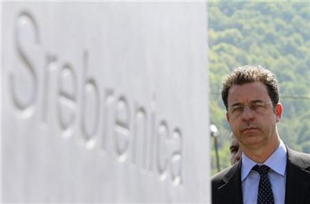 Serge Brammertz, chief prosecutor of the United Nations International Criminal Tribunal for the Former Yugoslavia, stands near a plaque at the Srebrenica Genocide Memorial in Potocari, near Srebrenica April 27, 1010. REUTERS/Dado Ruvic