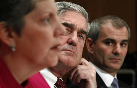 Homeland Security Secretary Janet Napolitano (L), FBI Director Robert Mueller (C) and National Counterterrorism Center Director Michael Leiter testify before the Senate Homeland Security and Governmental Affairs Committee hearing on ''Nine Years After 9/11: Confronting the Terrorist Threat to the Homeland'' on Capitol Hill, September 22, 2010. REUTERS/Kevin Lamarque