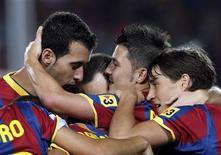 <p>David Villa comemora gol na vitória do Barcelona contra o o Sporting Gijon por 1 x 0 pelo Campeonato Espanhol. REUTERS/Albert Gea</p>