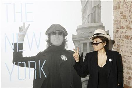 Yoko Ono gestures as she unveils the ''John Lennon: The New York City Years'' exhibit at the Rock & Roll Hall of Fame Annex in New York May 11, 2009. REUTERS/Lucas Jackson