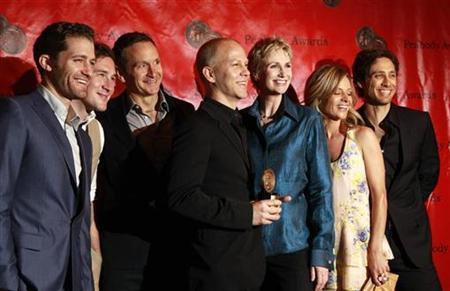 Creator and director of the show ''Glee'', Ryan Murphy (C), holds an award as he is surrounded by cast members during the 2010 Peabody Award ceremony at the Waldorf Astoria in New York May 17, 2010. The cast members include actors Matthew Morrison (L), Jane Lynch (3rd R) and Jessalyn Gilsig (2nd R). REUTERS/Lucas Jackson