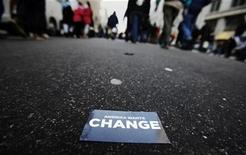"<p>A crowd of people makes its way down a street behind a card that reads ""America Wants Change"" en route to the inauguration ceremony of U.S. President Barack Obama in Washington, January 20, 2009. REUTERS/Mark Blinch</p>"