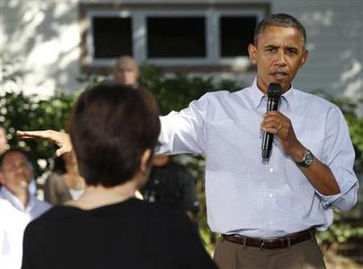 U.S. President Barack Obama visits the backyard of the home of Jeff and Sandy Clubb in Des Moines, Iowa, to discuss ways to jumpstart job creation and strengthen the middle class, September 29, 2010. REUTERS/Larry Downing