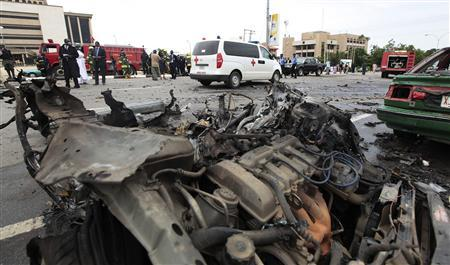 Security and rescue officials gather at the scene of a bomb blast in Abuja October 1, 2010. REUTERS/Afolabi Sotunde