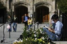 <p>A student read a book on the campus of Yale University in New Haven, Connecticut, October 7, 2009. REUTERS/Shannon Stapleton</p>