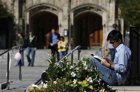 A student read a book on the campus of Yale University in New Haven, Connecticut, October 7, 2009. REUTERS/Shannon Stapleton