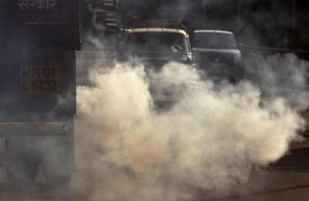 A truck emits smoke during evening rush hour in Mumbai November 19, 2009. REUTERS/Arko Datta