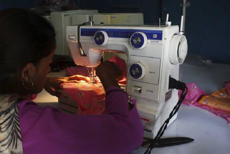 A woman uses sewing machine bought under a microfinance plan, in Ahmedabad, September 10, 2009. India's largest microlender SKS Microfinance fired chief executive Suresh Gurumani 18 months into the job and replaced him with his deputy. REUTERS/Amit Dave/Files