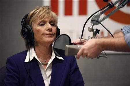 Senator Barbara Boxer waits as her microphone is adjusted for a radio debate with opponent Carly Fiorina, inside NPR Studios in Washington, September 29, 2010. REUTERS/Jason Reed
