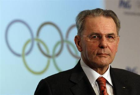 International Olympic Committee President Jacques Rogge smiles during a news conference announcing an IOC partnership with P&G in London July 28, 2010. REUTERS/Suzanne Plunkett/Files