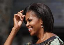 <p>First lady Michelle Obama fixes her hair while waiting to greet the spouses of chiefs of state and heads of government participating in the United Nations General Assembly at a special event held at Stone Barns Center in Westchester, New York September 24, 2010. REUTERS/Jessica Rinaldi</p>