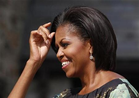 First lady Michelle Obama fixes her hair while waiting to greet the spouses of chiefs of state and heads of government participating in the United Nations General Assembly at a special event held at Stone Barns Center in Westchester, New York September 24, 2010. REUTERS/Jessica Rinaldi