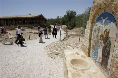 Tourists visit the site of the Baptism at the holy land of Jordan river May 6, 2009. REUTERS/Jamal Saidi/Files