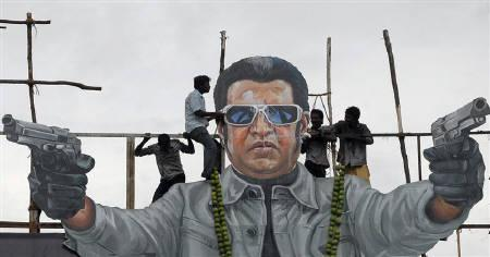 Fans of south Indian film star Rajinikanth pour milk as an offering over his cut-out on the release date of his new movie ''Endhiran'' (Robot) in Chennai October 1, 2010. REUTERS/Babu