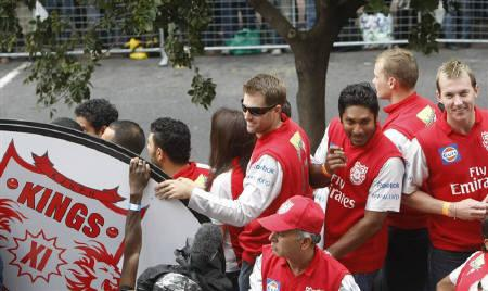 Files photo of members of the Kings XI Punjab cricket team waving to crowds in Cape Town, April 16, 2009.  REUTERS/Mike Hutchings/Files