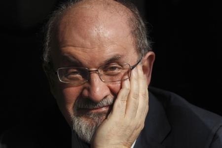 Author Salman Rushdie poses for a photograph after an interview with Reuters in central London, October 8, 2010. REUTERS/Andrew Winning