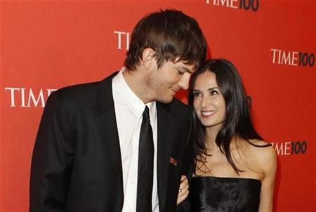 Actors Ashton Kutcher (L) and Demi Moore arrive for the ''Time Magazine's 100 Most Influential People in the World'' gala in New York May 4, 2010. Kutcher was named by Time Magazine as one of the 100 people they consider to be the most influential. REUTERS/Lucas Jackson
