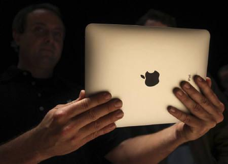 A host shows off the back of Apple's  ''iPad'' , a new tablet computing device, after its launch event in San Francisco, California, January 27, 2010. REUTERS/Kimberly White/Files