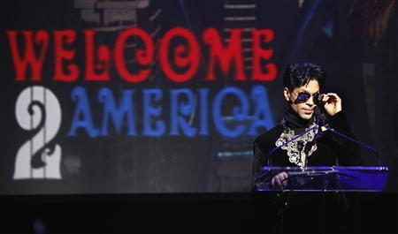 Singer Prince announces upcoming live dates during a press conference at the Apollo Theater in New York October 14, 2010. REUTERS/Lucas Jackson