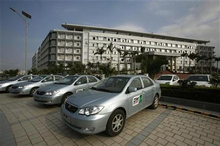 A BYD F3DM (Dual Mode) hybrid electric car is seen outside its headquarters in China's southern city of Shenzhen February 23, 2010. REUTERS/Bobby Yip