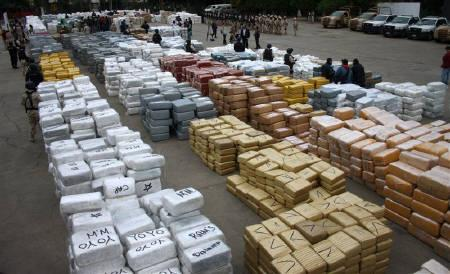 Narcotics wrapped in 10,000 brown and silver packages are on display in the patio of the Morelos military base in Tijuana October 18, 2010. REUTERS/Jorge Duenes