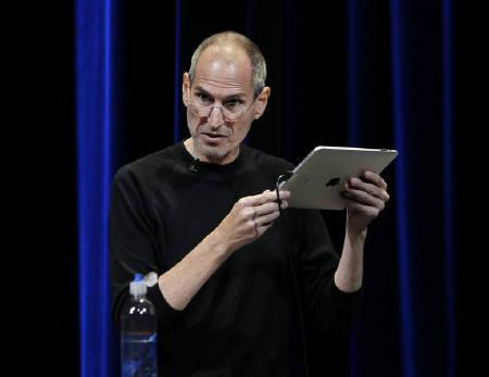 Apple Chief Executive Steve Jobs uses an iPad to run Apple TV as he speaks on stage at Apple's music-themed September media event in San Francisco, California September 1, 2010. REUTERS/Robert Galbraith/Files