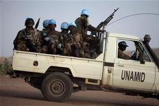 <p>Nigerian peacekeeping soldiers from the United Nations-African Union Mission in Darfur (UNAMID) patrol in Otash IDP's camp in Nyla, southern Darfur March 17,2009. REUTERS/Zohra Bensemra</p>