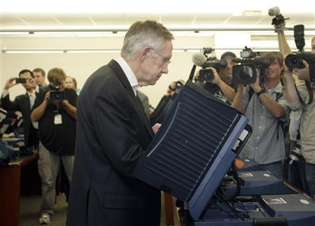 Senate Majority Leader Harry Reid votes at an early voting polling place after an early voting rally at the University of Nevada Las Vegas, in Las Vegas October 19, 2010. REUTERS/Las Vegas Sun/Steve Marcus