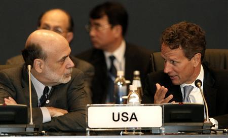 U.S. Treasury Secretary Timothy Geithner and Federal Reserve Chairman Ben Bernanke talk during the G20 Finance Ministers and Central Bank Governors meeting in Gyeongju, October 22, 2010. REUTERS/Ahn Young-joon/Pool