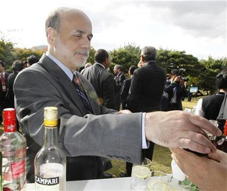 Fed Chairman Ben Bernanke receives a drink during a delegate reception in the G20 Finance Ministers and Central Bank Governors meeting in Gyeongju, southeast of Seoul, October 22, 2010. REUTERS/Jo Yong-Hak