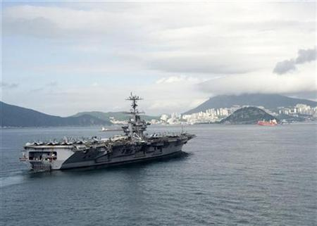 The USS George Washington arrives in Busan, South Korea, July 21, 2010. REUTERS/Charles Oki/U.S. Navy